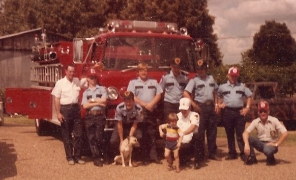 Elderville Lakeport Firemen Standing in Front of an American LaFrance/Ford Fire Engine